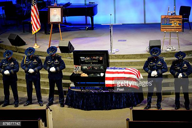 An honor guard of Louisiana State Police stands watch over the body of East Baton Rouge Sheriff deputy Brad Garafola at the Istrouma Baptist Church...