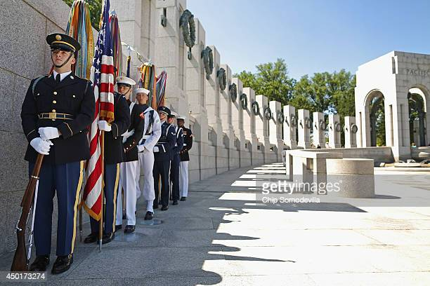 An honor guard prepares to participate in the 70th anniversary DDay commemoration at the WWII Memorial on the National Mall June 6 2014 in Washington...