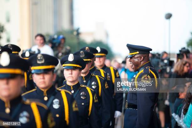 An honor guard procession marches to a Dallas Strong candlelight vigil outside City Hall in Dallas Texas on July 11 in honor of the five police...
