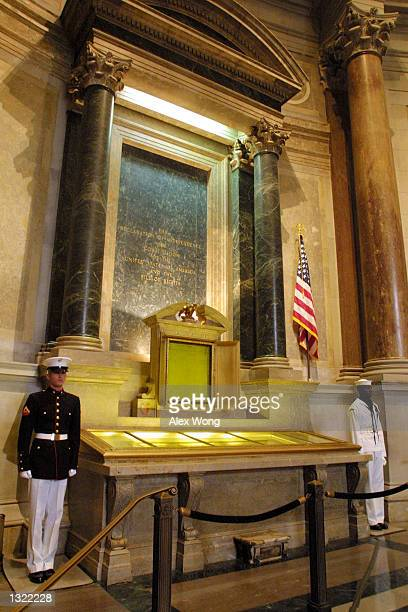 An honor guard stands next to the original copies of the Declaration of Independence the Constitution and the Bill of Rights July 4 2001 at the...