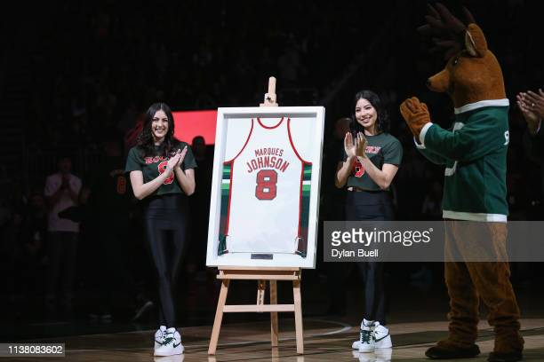 An honorary uniform is unveiled for former Milwaukee Bucks player Marques Johnson during a ceremony during the game between the Cleveland Cavaliers...