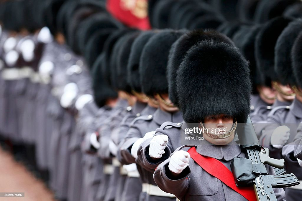 An honour guard arrives for an inspection by Kazakhstan President Nursultan Nazarbayev and Prince Philip, Duke of Edinburgh at Buckingham Palace on November 4, 2015 in London, England. The President of Kazakhstan is in the UK on an official visit as a guest of the British Government. He is accompanied by his wife and daughter, Dariga Nazarbayeva, who is also the Deputy Prime Minister.
