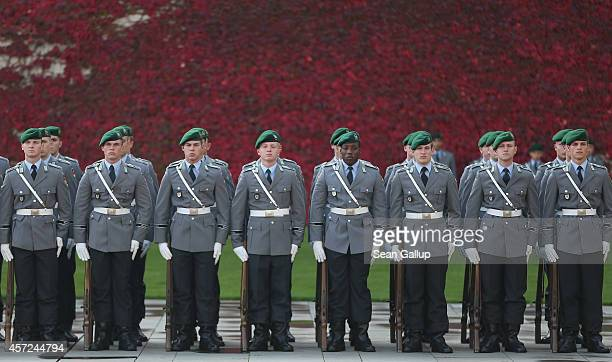 An honour guard of the Bundeswehr the German armed forces lines up against a backdrop of fall foliage prior to the arrival of Vietnamese Prime...