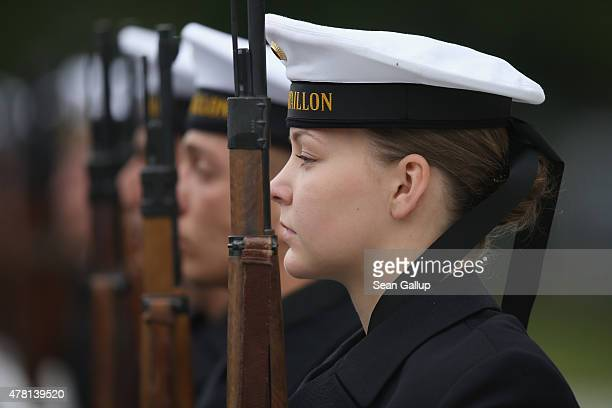 An honour guard of the German armed forces the Bundeswehr including a female soldier stands at attention during the visit of US Secretary of Defense...