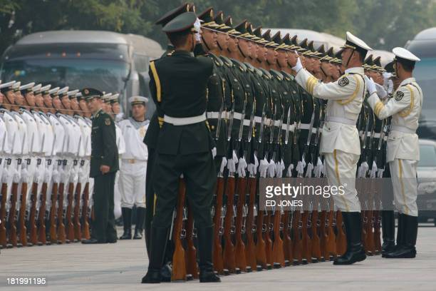 An honour guard prepares for a welcoming ceremony for Afghanistan's President Hamid Karzai at the Great Hall of the People in Beijing on September 27...