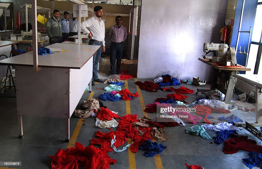 An hosiery factory unit at Sector 63 vandalized by angry mob of protesters during hours nationwide strike called by 11 national trade unions against UPA's economic and alleged anti-labour policies on February 20, 2013 in Noida, India. They also torched several vehicles parked outside the factory.
