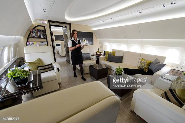 An hostess poses inside an Airbus ACJ319 business plane operated by K5 aviation during the European business aviation show EBACE on May 21 2014 in...