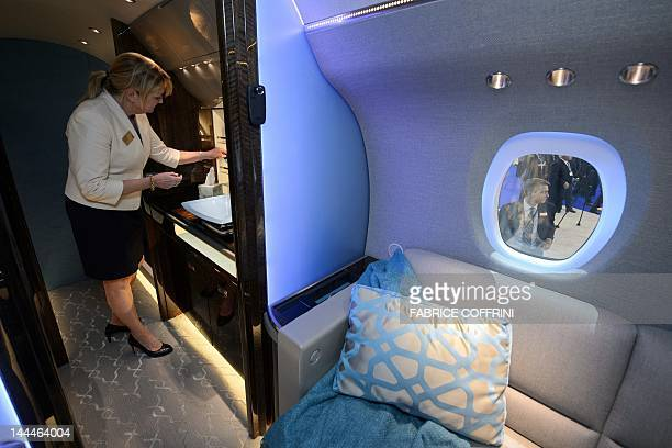 An hostess stands inside a mock up of the new business jet Citation Longitude unveilled on May 14 2012 at the European Business Aviation Convention...