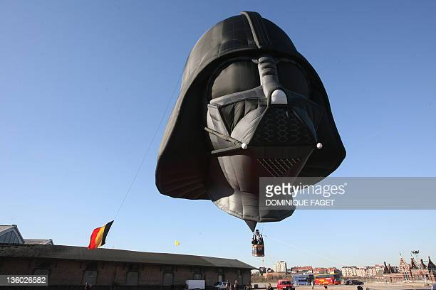 An hot air balloon in the shape of Darth Vader from the Star Wars is inflated at the Tours and Taxis site as part of the Star Wars exhibition on...