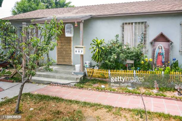 an house in a mexican immigrant neighborhood in compton in southern california - compton california stock pictures, royalty-free photos & images