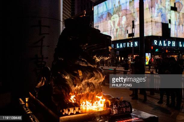 An HSBC lion statue is set on fire by a protester outside the bank's headquarters in Central area following a pro-democracy march in Hong Kong on...