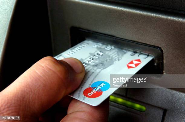 An HSBC Maestro debit card is being used in a cash machine