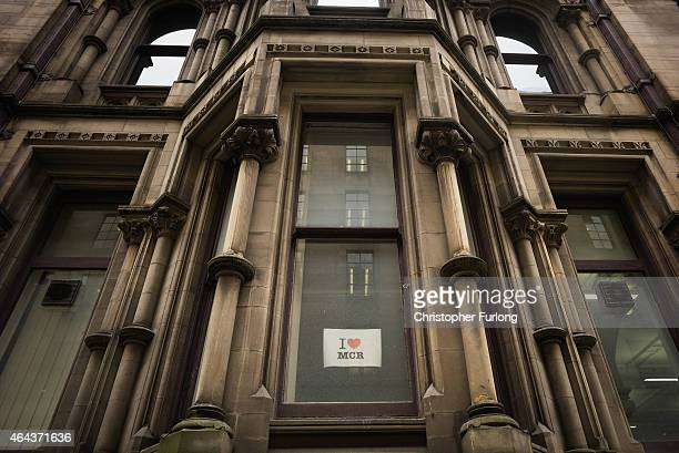 An 'I Love Manchester' poster is displayed in an office window of Manchester Town Hall after it was announced that local councils in Manchester will...