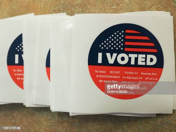 An I Voted sticker is seen at polling station during early voting for the midterm elections in the Lakeview Terrace neighborhood of Los Angeles...