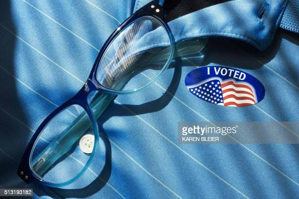 An 'I Voted sticker is worn by man who cast a ballot in the Virgina Super Tuesday primary March 1 20116 in Washington DC Americans began voting in...