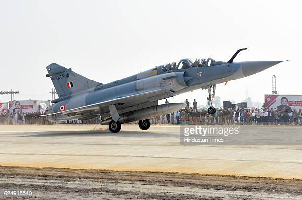 An IAF fighter jet Dassault Mirage2000 touches down on a stretch of the LucknowAgra Expressway on November 21 2016 in Unnao India Eight Indian Air...