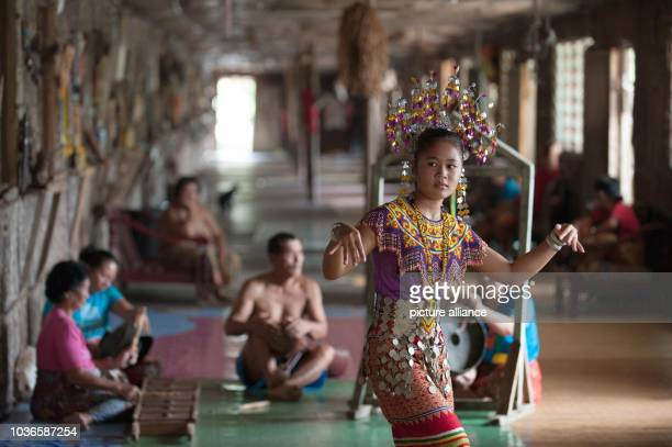 An Iban woman is performing a dance inside a traditional Iban longhouse near Lubok Antu Malaysia on 23 October 2014 Photo Sebastian Kahnert...