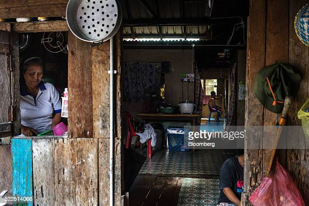 An Iban woman prepares food in the kitchen of a traditional longhouse in the village of Ensika in Simunjan district Sarawak Malaysia on Saturday...