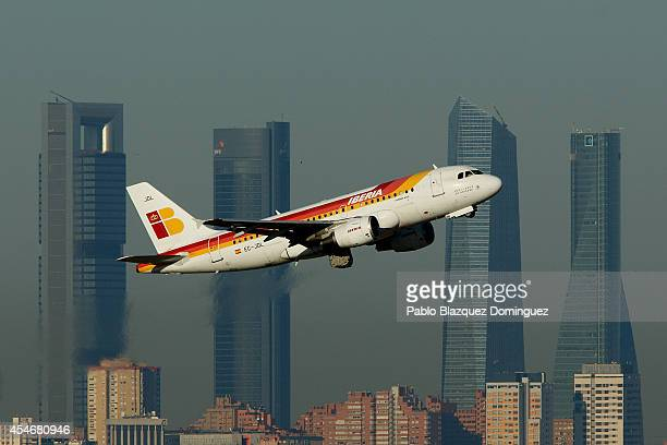 An Iberia airplane takes off in front of the Cuatro Torres business area on September 5 2014 in Madrid Spain Iberia British Airway's partner in IAG...