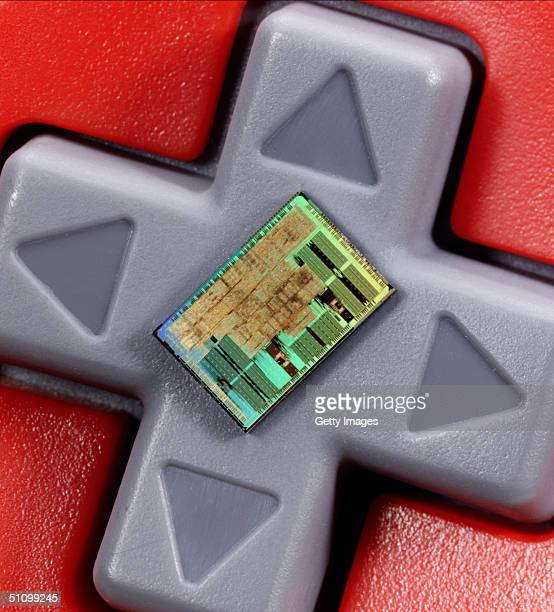 An Ibm Powerpc Copper Processor Chip On A Nintendo Game Controller The Technology Will Be Used In A New Venture Between Nintendo And Ibm To Support...