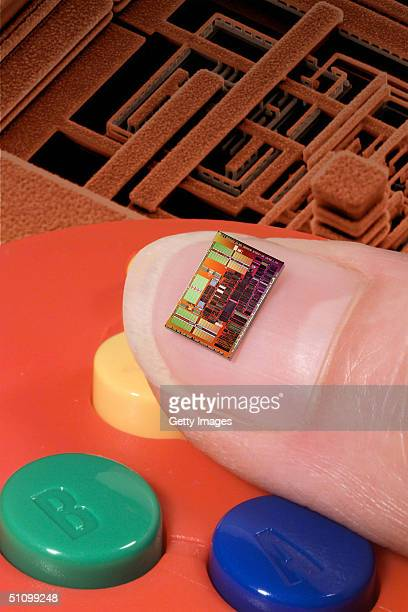 An Ibm Powerpc Copper Processor Chip On Thumbnail With A Nintendo Game Controller In The Background The Technology Will Be Used In A New Venture...