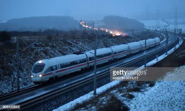 An ICE 3 highspeed train of German railway operator Deutsche Bahn drives near Arnstadt central Germany on the new track connecting Erfurt and...
