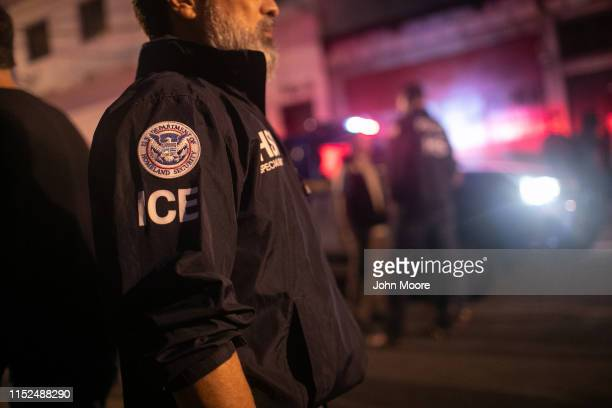 An ICE agent with US Homeland Security Investigations watches as Guatemalan police investigate the scene after detaining a suspected human trafficker...