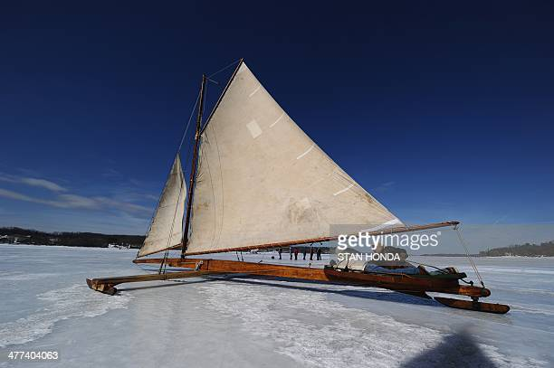 An ice boat sails across a frozen Hudson River March 7 2014 in Barrytown New York These historic 'ice yachts' some dating to the late 1800s or early...