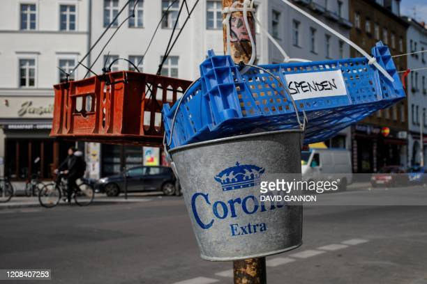 An ice bucket of the Corona beer brand has being hung at a collection point for donations of food and other items for the homeless set up in Berlin's...