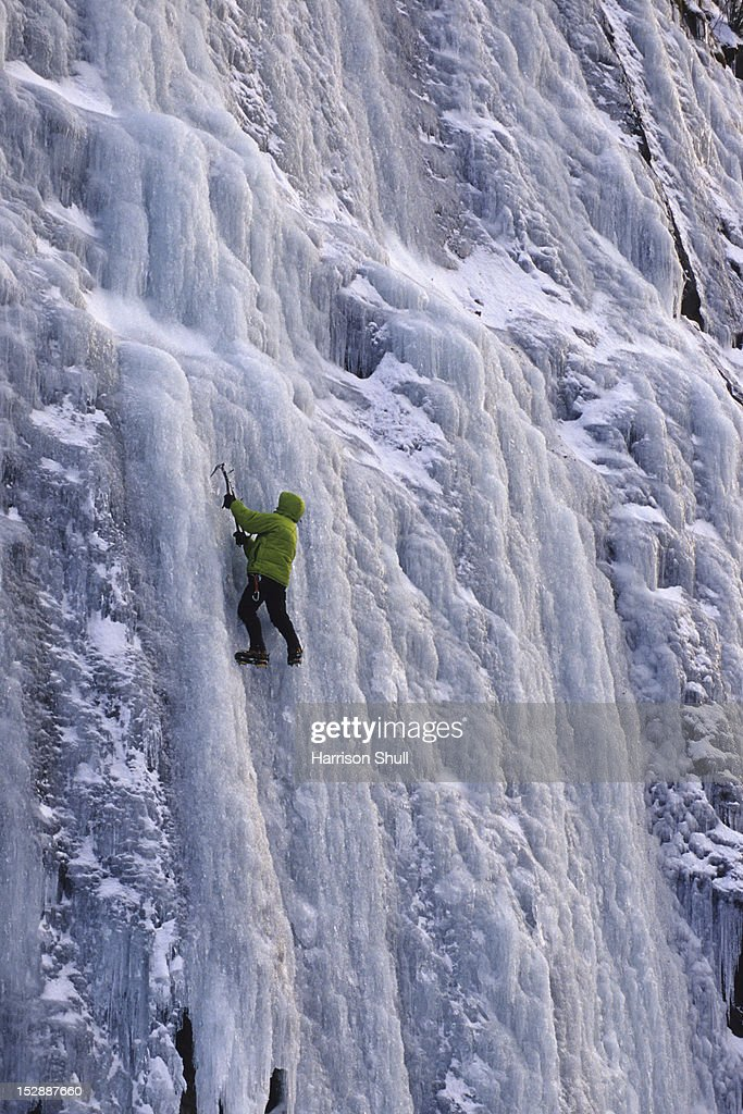 An ice climber boulders around at the ice at Winding Stair Gap on Hwy 64 near Franklin, NC : Stock Photo