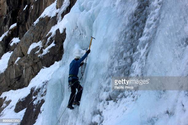 An ice climber scales an ice wall at Chandanwari in Pahalgam