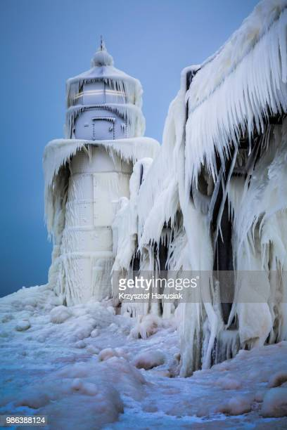 an ice covered lighthouse at tiscornia park in michigan, usa. - saint joseph stock pictures, royalty-free photos & images