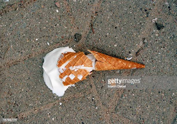 An ice cream dropped on the pavement