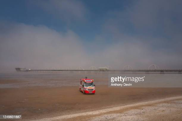 An ice cream van waits for customers as sea mist blows across the beach at Southport on June 15, 2020 in Southport, England. The British government...