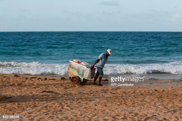An Ice Cream Vendor Pulls A Cart At The Beach Before Aned News Photo Getty Images