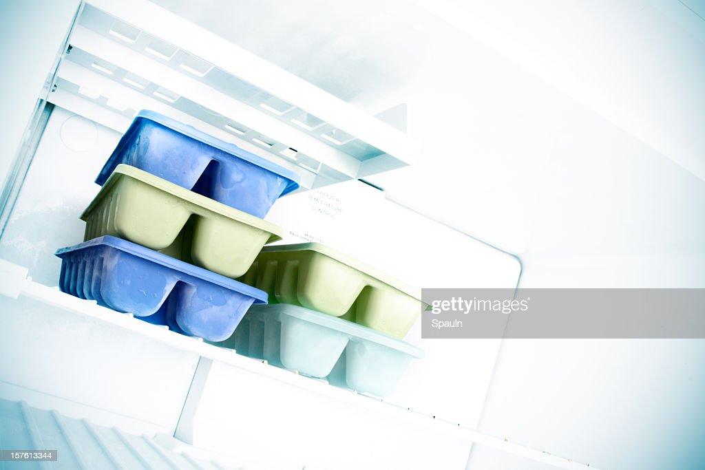 An ice cube trays inside the freezer : Stock Photo
