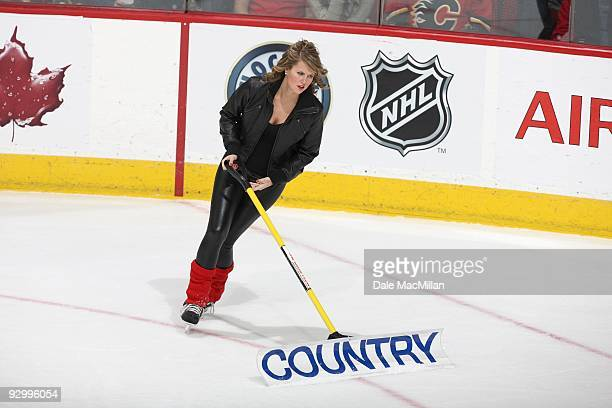 An Ice Girl cleans the ice during a break in play between the Detroit Red Wings and the Calgary Flames on October 31 2009 at the Pengrowth Saddledome...