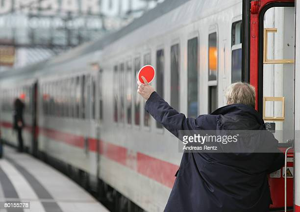 An ICE highspeed train operated by German state railways Deutsche Bahn leaves the Central Station on March 7 2008 in Berlin Germany The German union...