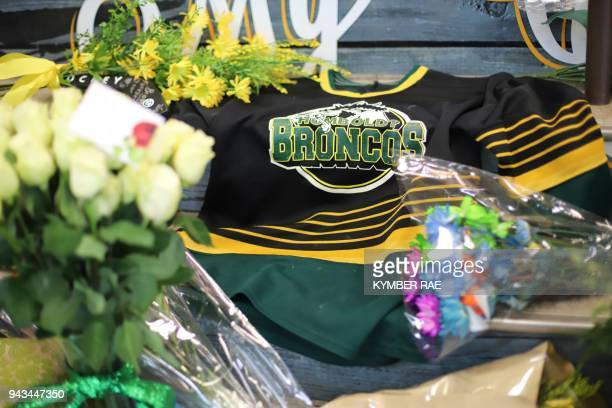 An ice hockey jersey is left in a makeshift memorial at the Humboldt Uniplex in Humboldt Canada on April 8 2018 Canadian Prime Minister Justin...