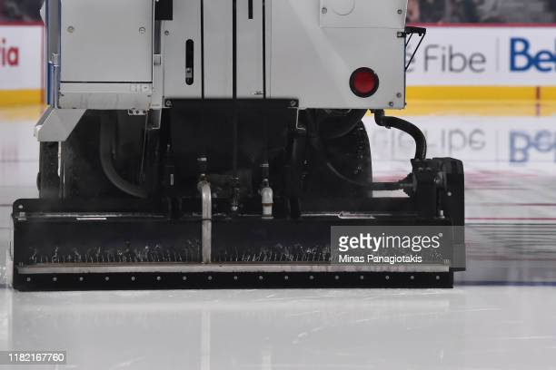 An ice resurfacing machine floods the ice prior to the game between the Montreal Canadiens and the Minnesota Wild at the Bell Centre on October 17...