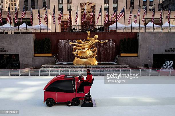 An ice resurfacing vehicle smooths the surface of the ice rink at the Rockefeller Center October 11 2016 in New York CityThe iconic ice rink opened...
