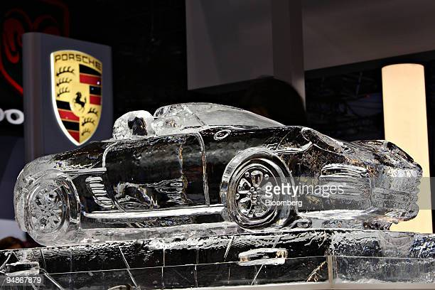An ice sculpture of a 2008 Porsche Boxter RS 60 Spyder sits on display during a media preview of the 2008 New York International Auto Show in New...
