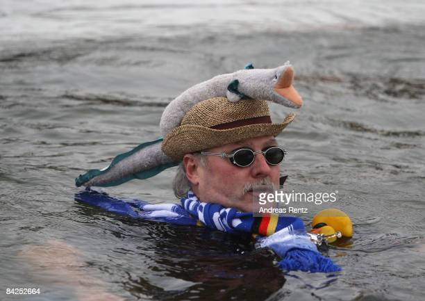 An ice swimmers takes a dip in Orankesee lake on January 10 2009 in Berlin Germany Around 120 ice swimmers nationwide celebrate the 'Berliner...