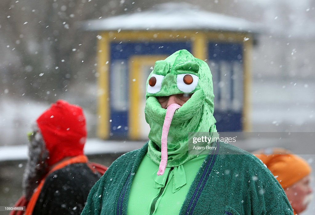 An ice swimming enthusiast dressed as a frog prepares to enter the cold waters of Orankesee lake during the 'Winter Swimming in Berlin' event on January 12, 2013 in Berlin, Germany. A local swimmers' group called the 'Berlin Seals' invite ice swimmers from across Germany and abroad to the annual event, which, despite warmer temperatures this winter and a lack of ice, was still held. Members claim ice swimming is good for the body's blood circulation.