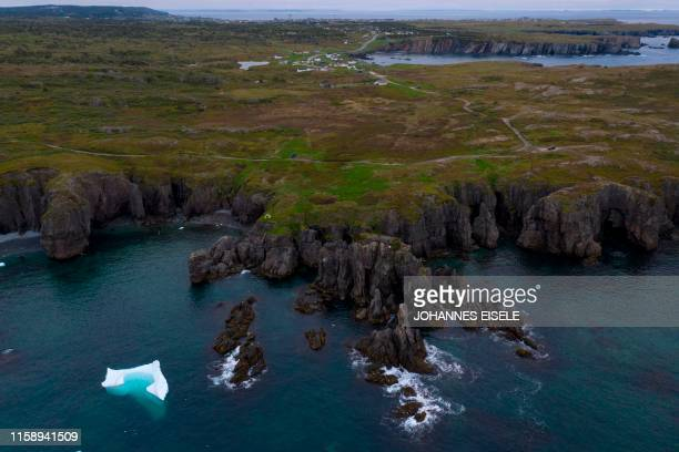 An iceberg floats near Bonavista in the early morning of July 7, 2019 in Newfoundland, Canada. - Iceberg water, considered pure, is now marketing for...