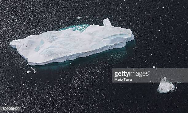 An iceberg floats near the coast of West Antarctica as seen from a window of a NASA Operation IceBridge airplane on October 27 2016 inflight over...