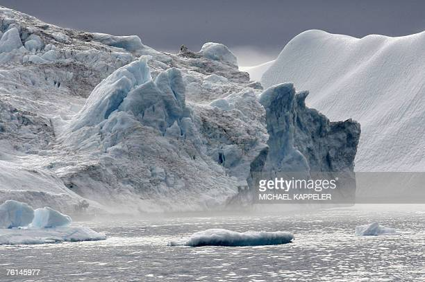 An iceberg floats through a fjord near Ilulissat in Greenland 16 August 2007 German Chancellor Angela Merkel and German Environment Minister Sigmar...