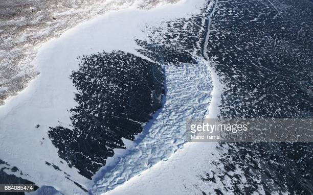 An iceberg is locked in sea ice as seen from NASA's Operation IceBridge research aircraft along the Upper Baffin Bay coast on March 27 2017 above...