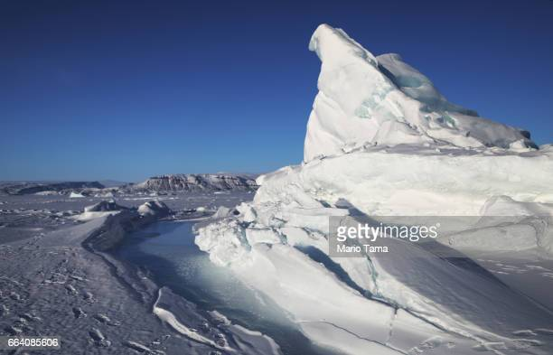 An iceberg is locked in sea ice near Thule Air Base on March 25 2017 in Pituffik Greenland NASA's Operation IceBridge is flying research missions out...