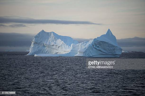An iceberg is pictured in the western Antarctic peninsula on March 02 2016 Like seals and whales penguins eat krill an inchlong shrimplike crustacean...